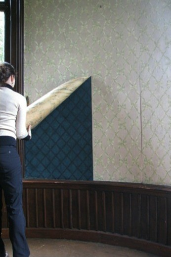 The original dark green 1860's wallpaper was discovered underneath